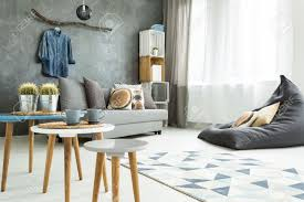 modern minimalistic and bright living room in shades of cyan
