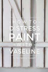 How To Distress White Kitchen Cabinets How To Distress Paint With Vaseline Love Grows Wild