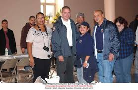 nycd hispanic society give out thanksgiving dinners at immaculate