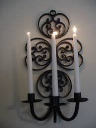country wrought iron ornamental hanging candle stylized