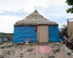 build a house refugees use scraps to build houses that remind them of home
