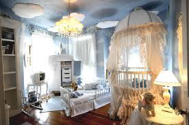 blue striped sofa beside crib baby corner boy white baby bedding