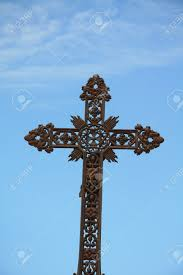 cast iron cross grave ornament on an cemetery in the