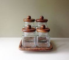 gorgeous pair of vintage green glass canisters with wooden tops