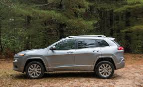 jeep cherokee sport interior 2016 2018 jeep cherokee in depth model review car and driver