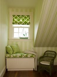 this or that the long and short of built in window seats cococozy short window seat with green and white cushion striped accent pillows and a slanted ceiling