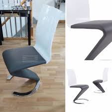 White Leather Dining Chairs Uk by Leona High Gloss And Leather Dining Chairs In Stylish Grey And