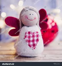 Christmas Angel Window Decorations by Small Christmas Angel Red Wings Family Stock Photo 231688954