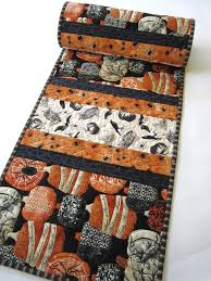 halloween quilted table runner with spiders and pumpkins