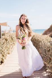 boho beach wedding with bride in high street separates