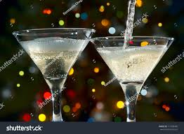champagne glasses on background christmas lights stock photo
