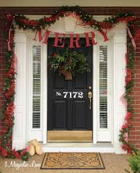green front porch light merry banner garland ribbon red and green front porch christmas