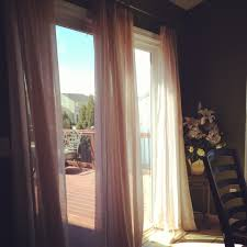 use curtains instead of vertical blinds on your sliding door we