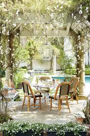 inspired outdoor entertaining from domino how to decorate outdoor entertaining under a pergola with ballard designs and domino magazine