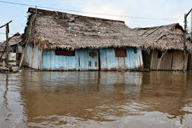 houses on stilts rise above polluted water in belen iquitos