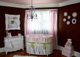 baby nursery dark brown paint on the wall with round white wood