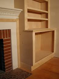 fireplace with bookcases on sides side shelf some of the