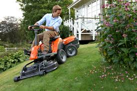 what are the differences between ride on mowers and garden tractors