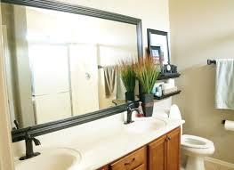 add a wood frame around a plain mirror diy how to frame a bathroom