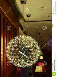elegant ceiling lighting lit up by led lamp bulbs stock photo
