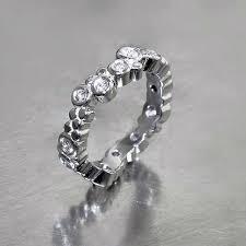 set diamond item 21110107 wavy bezel set diamond ring platinum