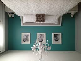 teal and gray bedroom example of a minimalist bedroom design in