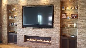 Mounting A Tv Over A Gas Fireplace by Design Debate Is It Ok To Hang The Tv Over The Fireplace