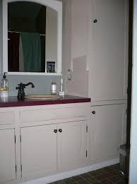 bathroom linen closet ideas white wooden linen cabinets having purple top and round washbasin