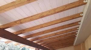 montaggio tettoia in legno portico addossato in lamellare