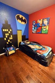 boy u0027s batman superhero themed room with bat signal over the city