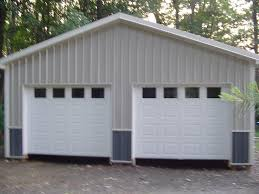 modern grey nuance of the pole barn garage kits with loft that has