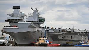 massive new aircraft carrier pushes from dock cnn video