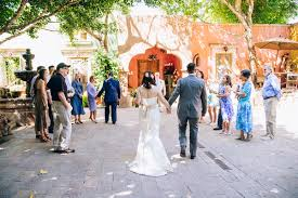 small wedding ceremony and groom entering wedding ceremony together during