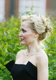 gillian anderson fashion rules dresses from the collections of