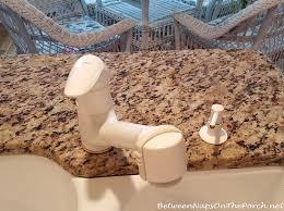 some kitchen updates a moen motionsense faucet and moen detergent