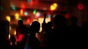 Jumping Light Silhouette Of A Dancing Man Jumping Into A Crowd Of People On A