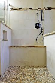 master shower design mosaic pebble floor beige tile and granite