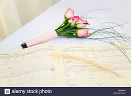 wedding register a wedding register and quill with a bouquet of pink roses on a