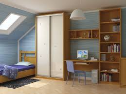 inspiring attic boys bedroom design with roof window above brown