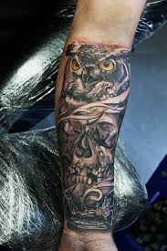 owl and skull tattoos on forearm owl and tattoos