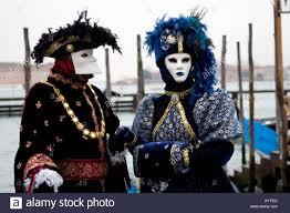 carnevale costumes two colourful costumes and masks carnevale di venezia carneval
