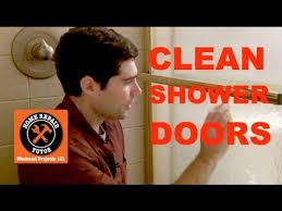 how to clean soap scum off shower doors by home repair tutor