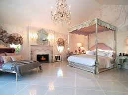 traditional guest bedroom with chandelier onyx tile floors in