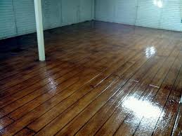 an acrylic cement concrete coating made to look like hardwood