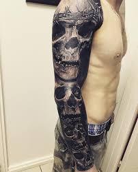 skulls on guys arm best design ideas