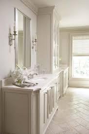 Dual Vanity Bathroom by Dual Vanities With Storage Cabinet Between Love The Limestone In