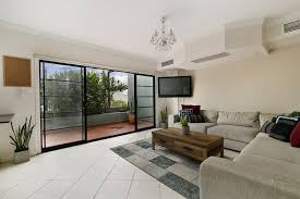couch in front of sliding glass door for large living room design