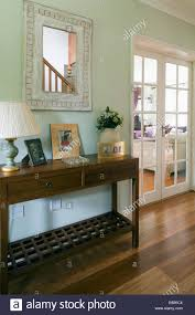 Green Console Table White Framed Mirror Above Console Table In Pastel Green Country