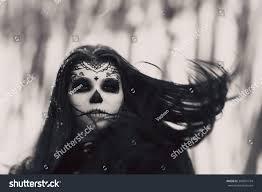 beautiful woman halloween sugar skull makeup stock photo 398601754