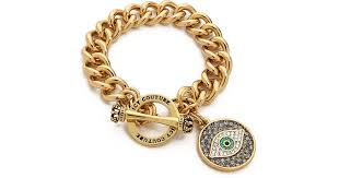eye charm bracelet images Lyst juicy couture pave evil eye charm bracelet gold in metallic jpeg